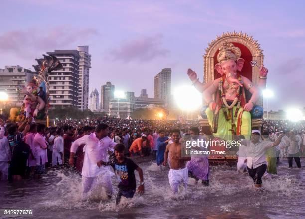 Devotees prepare to immerse idols of elephantheaded Hindu God Ganesha in the Arabian Sea marking the end of the 10day long Ganesh Chaturthi festival...