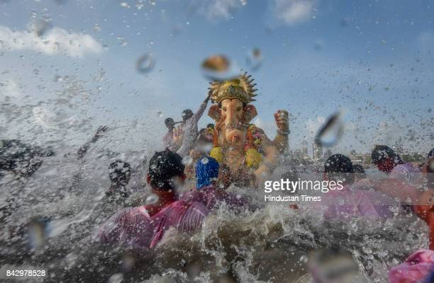 Devotees prepare to immerse idols of elephantheaded Hindu God Ganesha in the Arabian Sea marking the end of the 10day long Ganesh Chaturthi festival...