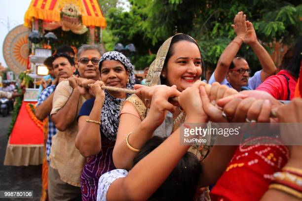 Devotees pull the chariots of Lord Jagannath during the 141st Rath Yatra at Shri Damodar Temple in Jaipur Rajasthan India on 14 July2018