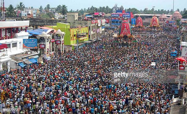 Devotees pull the chariots of Lord Jagannath his brother Balabhadra and sister Devi Subhadra in front of the Lord Jagannath temple during the...