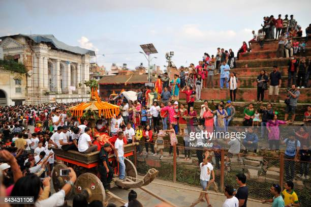 Devotees pulling the chariot of God 'Bhairab' on the fourth day of Indra Jatra Festival celebrated at Basantapur Durbar Square Kathmandu Nepal on...