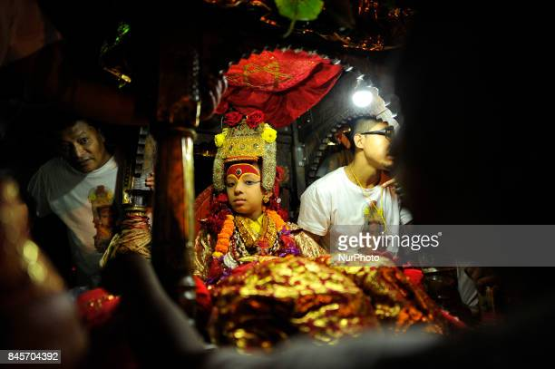 Devotees pulling the chariot of God Ganesh on the last day of Indra Jatra Festival celebrated in Basantapur Durbar Square Kathmandu Nepal on Sunday...