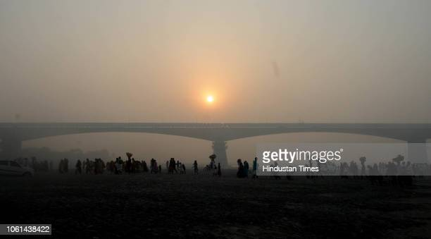 Devotees return from Ganga river after completing their rituals of Chatth Mahaparva festival at river Ganga on November 14 2018 in Patna India...