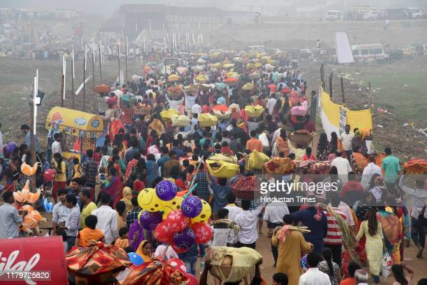 Devotees returning after performing Chhath Puja rituals at Digha Ghat on November 3 2019 in Patna India Thousands of devotees celebrating Chhath Puja...