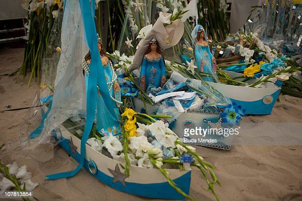 Devotees salute Yemanja, Goddess of the Sea, during a ceremony as part of traditional New Year's celebrations on the sands of Copacabana beach on...