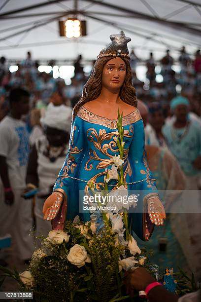 Devotees salute Yemanja Goddess of the Sea during a ceremony as part of traditional New Year's celebrations on the sands of Copacabana beach on...