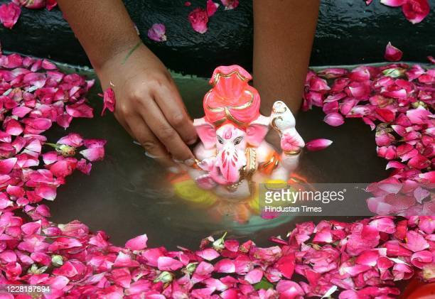 Devotees seen immersing Idols of Hindu deity Ganesh at Delhi ka Maharaja go for eco-friendly Ganpati Visarjan at Laxmi Nagar on August 24, 2020 in...
