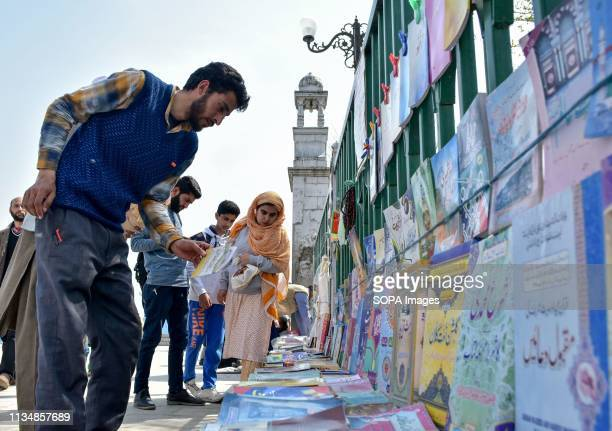 Devotees seen looking for religious book during the occasion ShabeMeraj the night when the Holy Prophet Muhammad ascended to the highest levels of...