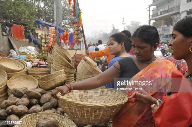 Devotees seen purchasing things ahead of the upcoming Chhath Puja festival at Sector 5 market on November 1 2019 in Noida India The Chhath festival...