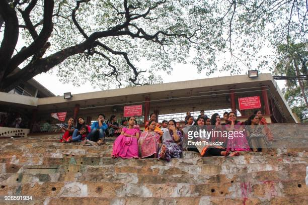 Devotees sitting on steps of Kamakhya Temple.