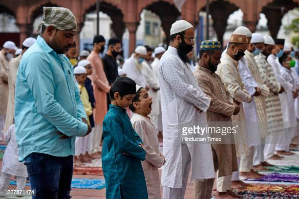 Devotees, some wearing face masks, offer prayers on the occasion of Eid al-Adha at Jama Masjid, on August 1, 2020 in New Delhi, India. The holy...
