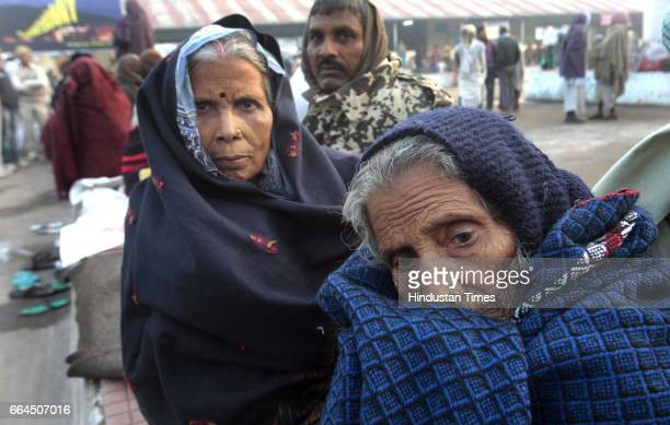Devotees stuck at rambaug railway station as the train mishap lead to cancellations and reschedulind of several trains inl Allahabad