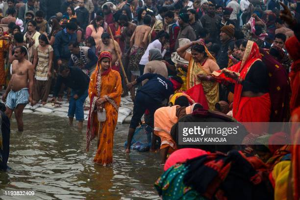 Devotees take a holy dip on the occasion of the Makar Sankranti festival during the annual Hindu 'Magh Mela' festival at Sangam the confluence of the...