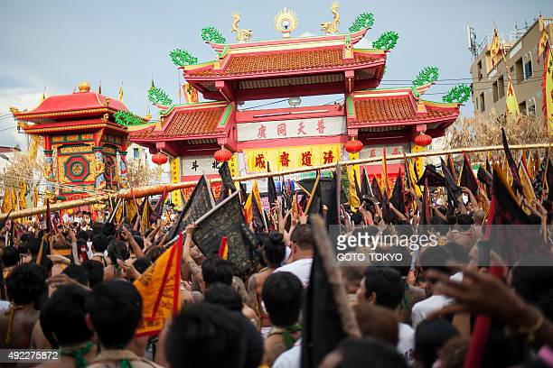 Devotees take a part in a vegetarian festival in Phuket