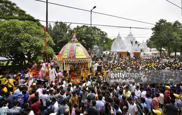Devotees take part in pulling a chariot of Lord Jagannath Rath Yatra at Hauz Khas on June 25 2017 in New Delhi India Ratha Yatra or Ratha Jatra or...