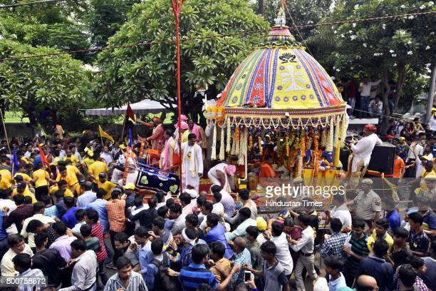 Devotees take part in pulling a chariot of Lord Jagannath Rath Yatra at Hauz Khas on June 25 2017 in New Delhi India Ratha Yatra or Ratha Jatra or...