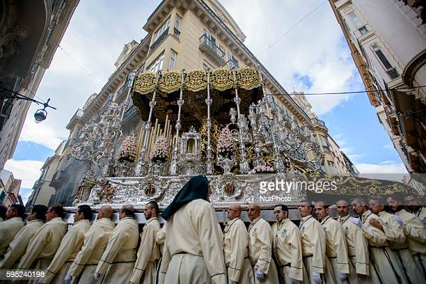 Devotees take part in the 'el domingo de los Ramos' procession on March 20 2016 in Malaga during the Holy Week Christian believers around the world...