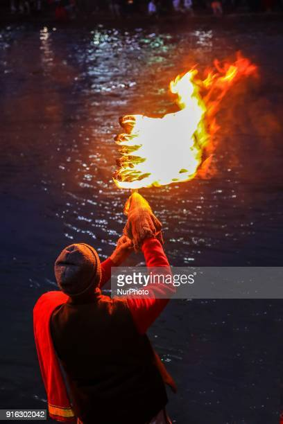 Devotees take part in the Goddess Ganga aarti ' Paryer' at Har ki Pauri in Haridwar Uttrakhand India on 8th Feb 2018 The priests perform prayers with...