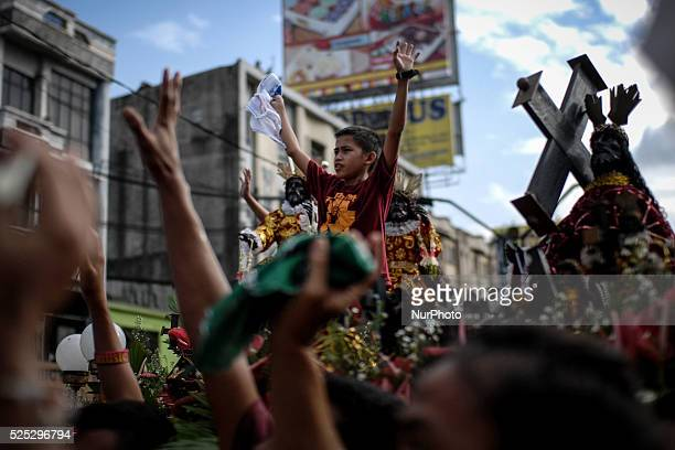 Devotees take part in the parade of the Black Nazarene replicas in Manila Philippines January 7 2014 The Black Nazarene is a sculpture of a cross...