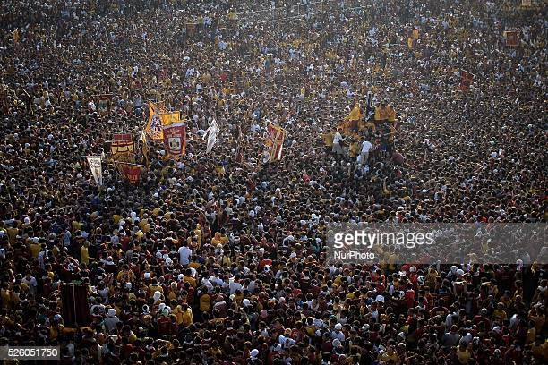 Devotees take part in the procession of the Black Nazarene in Manila Philippines January 9 2014 The Black Nazarene is a sculpture of a cross carrying...