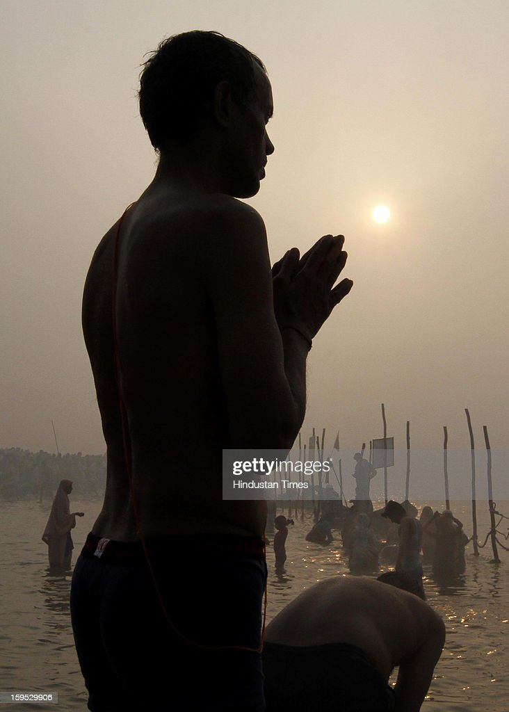 Devotees takes a dip in the morning at the bank of Sangam confluence of river Ganga, Yamnuna and mythical Saraswati on the occasion of Makar Sankranti on January 15, 2013 in Allahabad, India. Kumbh is World's biggest religious gathering, in which more than 100 million of Hindus and sikh devotees will take part over next 55 days. Apart from being pilgrimage of faith, salvation and hope for millions of devotees, it also serve as meeting ground for the vast spectrum of Indian religious and spiritual views.