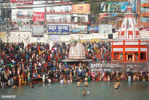 Devotees taking holy dip at Har Ki Pauri on the bank of the river Ganga on the first bath of Ardh Kumbh fair 2016 on January 14 2016 in Haridwar...