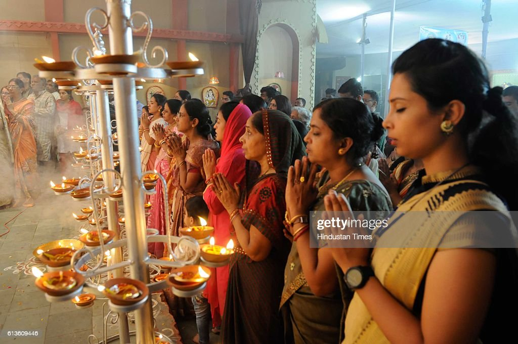 Devotees taking part in Sandhi Puja at TT Nagar Kalibari during the Durga Puja celebrations, on October 9, 2016 in Bhopal, India. Durga Ashtami or Maha Ashtami is one of the most auspicious days of ten-day long Durga Puja festival. This day is also known for 'Astra Puja' (weapons' worship) as the weapons of Goddess Durga are worshiped on this day.