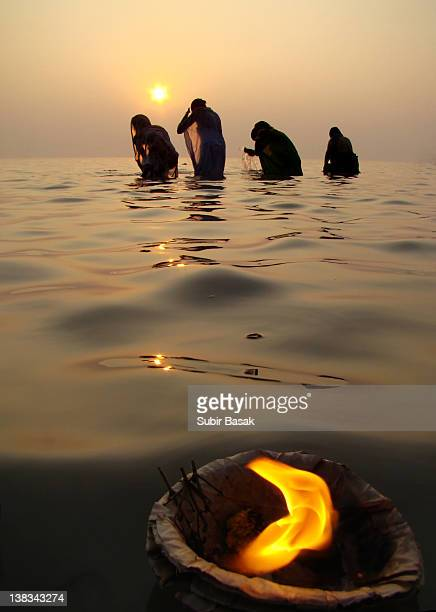 devotees taking their holy dip at ganges - river ganges stock pictures, royalty-free photos & images