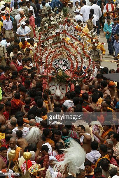 Devotees throng around chariots in front of the Shree Jagannath temple as they pull Lord Jagannath Brother Balabhadra and Devi Subhadras chariot to...