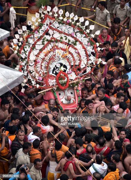 Devotees throng around the icon of Balabhadra brother of the Hindu deity Jagannath is brought out from the Jagannath temple during the annual Hindu...