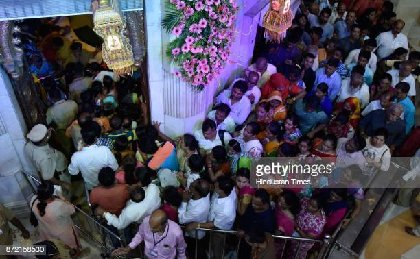 Devotees throng at Siddhivinayak Temple on the occasion of Angarki Sankashti Chaturthi on November 7 2017 in Mumbai India This day is celebrated in...