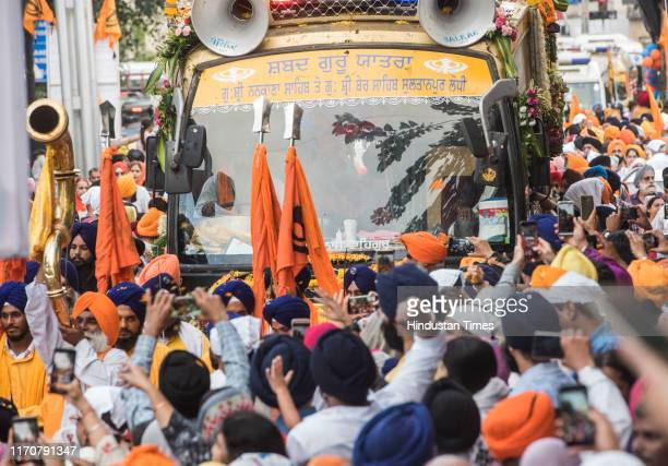 Devotees throng for a glimpse of kharaon or wooden sandals of Sikhism's founder Guru Nanak at Gurudwara Dhan Pothohar Nagar Santacruz West on...