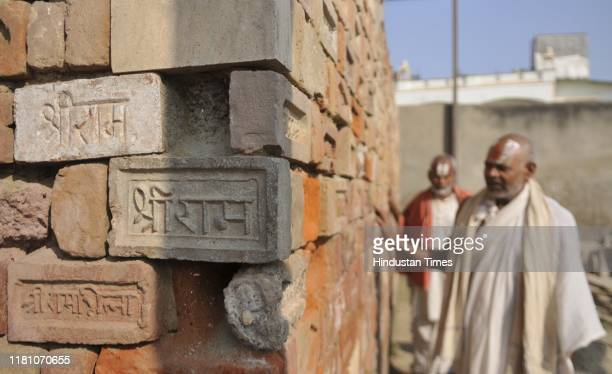 Devotees touch bricks with 'Shri Ram' embossed and engraved on them during a visit to the Ram Janambhoomi Nyas workshop at Karsevak Puram on the day...