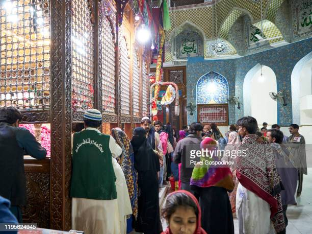 devotees visit the the shrine of lal shahbaz qalandar shrine in sehwan, pakistan - lal shahbaz qalandar stock pictures, royalty-free photos & images
