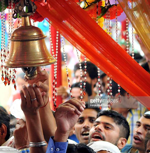 Devotees wait in a queue to offer prayers on the first day of Navratras at Babe Wali Mata temple on October 13 2015 in Jammu India The ninedaylong...