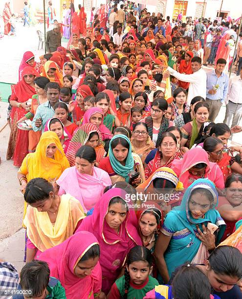 Devotees wait to perform worship at Sri Laleshwar Mahadev Mandir in Bikaner India