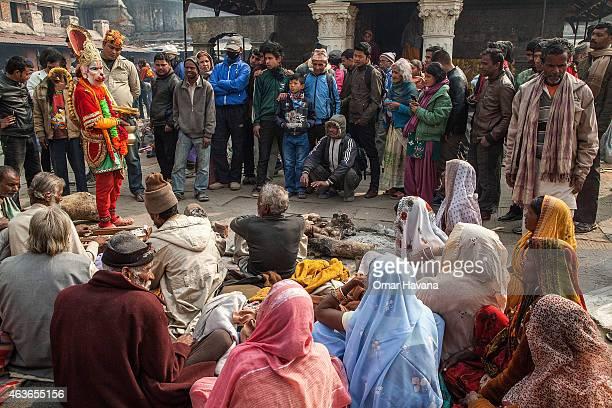 Devotees watch a dance inside Pashupatinath temple during the celebration of the Maha Shivaratri festival on February 17 2015 in Kathmandu Nepal...