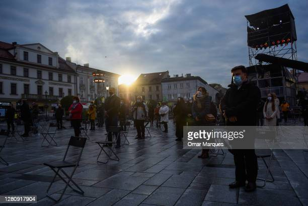 Devotees wear protective face masks and take part in a mass under social distance measures before a concert to celebrate the delayed 100th...