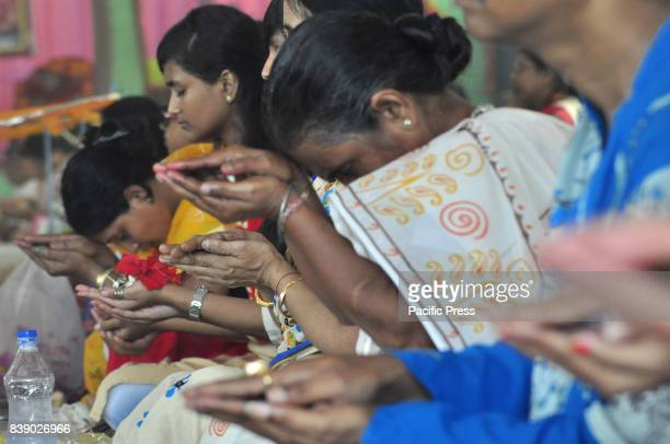 Devotes are doing rituals during Ganesh Puja at a temple in Agartala capital of the northeastern state of Tripura
