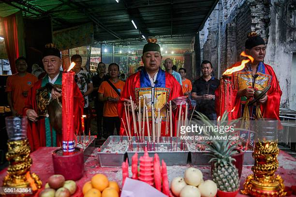 A devotes perform a prayer during Hungry Ghost Festival on August 5 2016 in Kuala Lumpur Malaysia The Hungry Ghost Festival falls on the 15th day of...