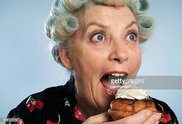 devouring 02 - fat old lady stock photos and pictures