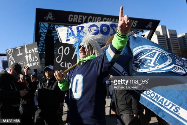 TORONTO ON NOVEMBER 28 Devout fan Paul Burton joins the crowd The Toronto Argonauts football club celebrated their Grey Cup victory over the Calgary...