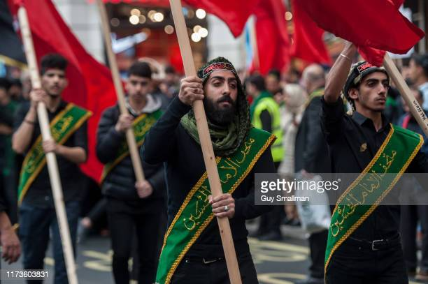 Devout Shia Muslims march from Marble Arch to Whitehall to mark Ashura at Oxford street on September 10 2019 in London England Ashura is the mourning...