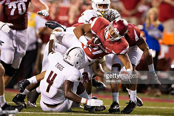 Devwah Whaley of the Arkansas Razorbacks dives over the defense during the first half of a game against the Texas State Bobcats at Razorback Stadium...