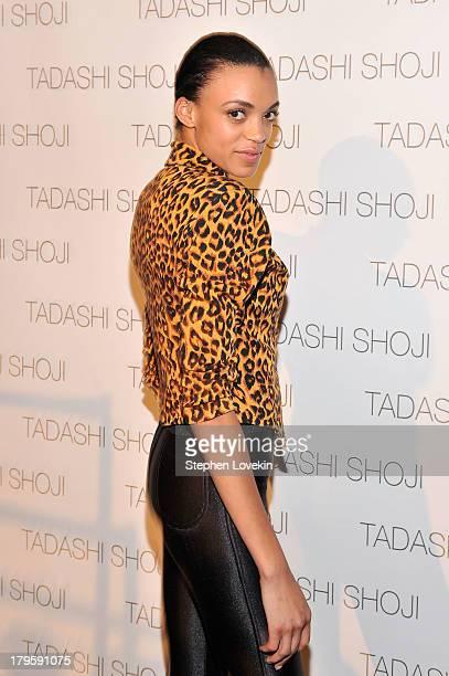 Devyn Abdullah prepares backstage at the Tadashi Shoji Spring 2014 fashion show during MercedesBenz Fashion Week at The Stage at Lincoln Center on...