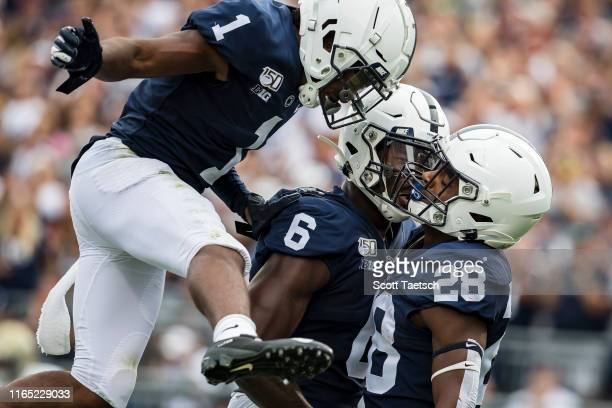 Devyn Ford of the Penn State Nittany Lions celebrates with KJ Hamler and Justin Shorter after scoring a touchdown against the Idaho Vandals during...