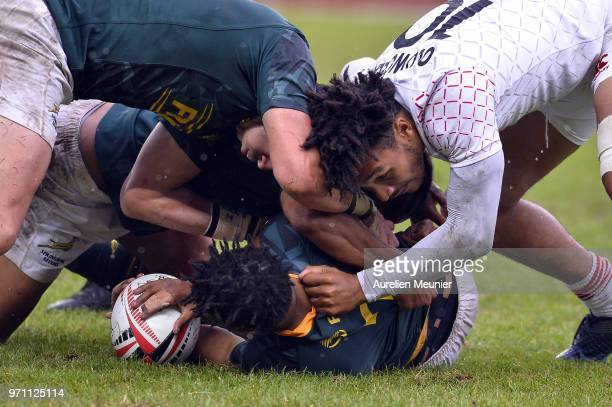 Dewald Human of South Africa and Ryan Olowofela of England fight for the ball during the match between England and South Africa at the HSBC Paris...