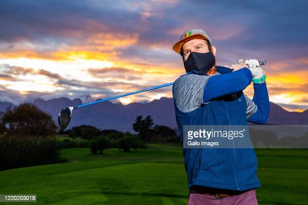 Dewald Viljoen plays golf on the first day of the lifting of restrictions on Level 3 at Strand Golf Club on Day 79 of the National Lockdown on June...