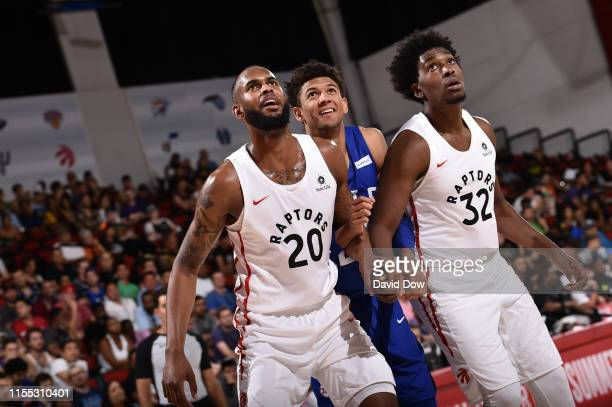 Dewan Hernandez of the Toronto Raptors and Matisse Thybulle of the Philadelphia 76ers fights for position to grab the rebound during Day 8 of the...