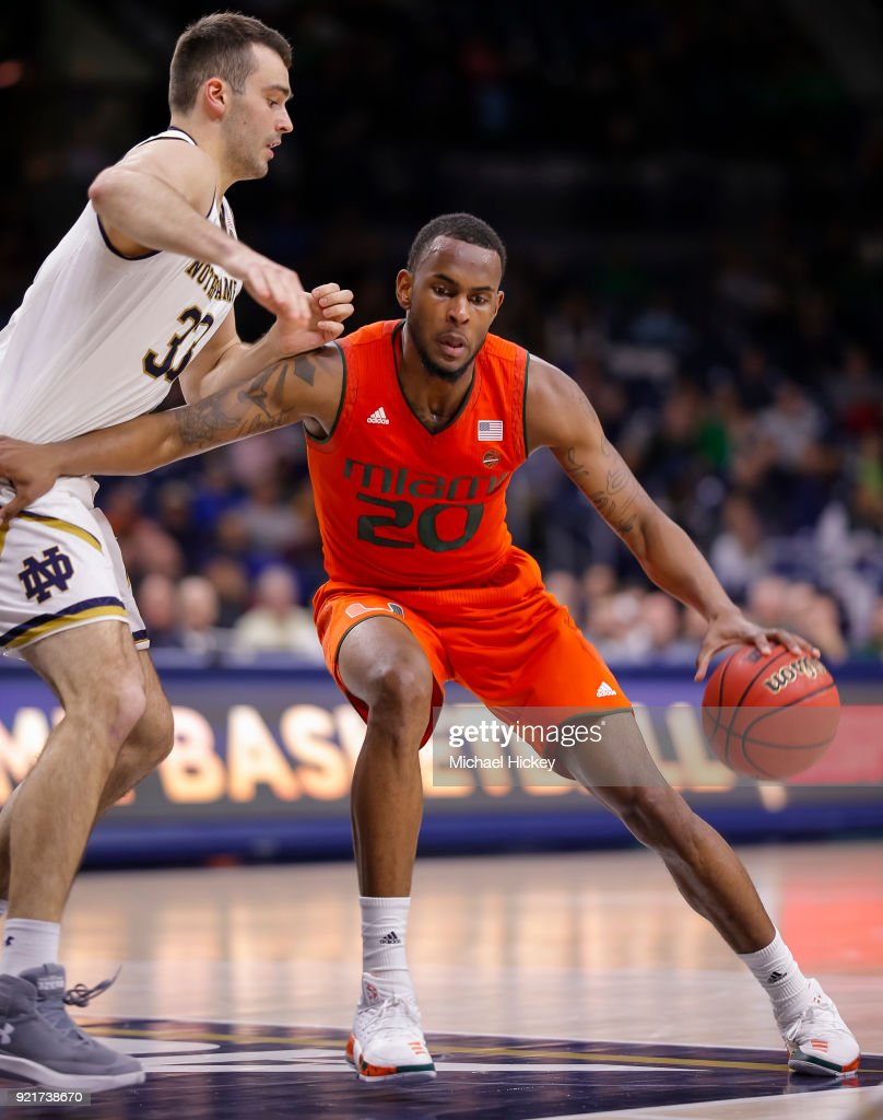Dewan Huell #20 of the Miami (Fl) Hurricanes dribbles against John Mooney #33 of the Notre Dame Fighting Irish during the game against the Notre Dame Fighting Irish at Purcell Pavilion on February 19, 2018 in South Bend, Indiana.